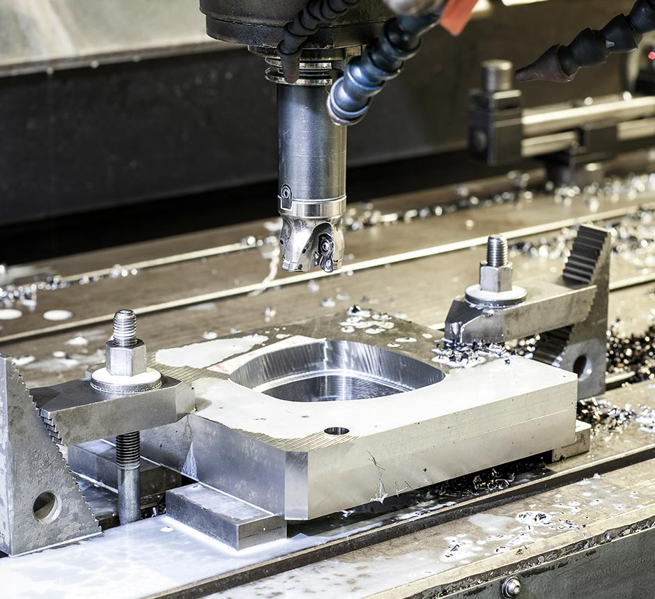 Machine welding stainless steel in a factory
